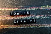 Public Affairs On Wooden Blocks. Cross Processed Image With Blackboard Background. Inspiration, Educ poster