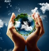 stock photo of ecosystem  - holding a glowing earth globe in his hands - JPG