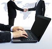 laptop, shake hands