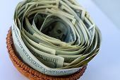Full Wicker Basket With Money. A Full Plate Of Paper Money. Lots Of Green Cash In A Wicker Basket Fo poster