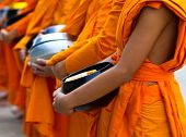 stock photo of yangon  - Offer food to monk on early morning - JPG