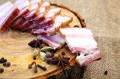 Smoked Bacon, Sliced On A Wooden Plank. Smoked Bacon, Red Onion, Salt And Pepper On A Clay Dish. Smo poster