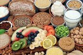 Health food for vegans with almond butter, yoghurt & milk, tofu bean curd, grains, seeds, nuts, frui poster