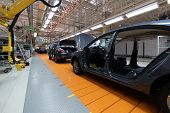 Assembled Car Is On The Assembly Line. Robotic Equipment Makes The Assembly Of The Car. Modern Car A poster