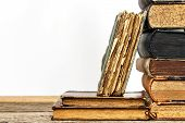 Old Books On A Wooden Shelf On A White Background. Study Of Old Books. Damaged Books. Old Library. poster