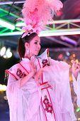 thai ladyboy dancing on stage during night show, pattaya, thailand
