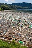 beautiful landscape ruined by  trash pollution, Bicaz lake, Romania