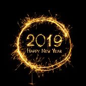 Happy New Year 2019. Golden Text Happy New Year 2019 In Round Frame Written Burning Sparklers Isolat poster