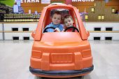 Children In Toy Automobile In Supermarket 2