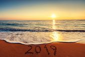 Happy New Year 2019 Concept, Lettering On The Beach. Sea Sunrise. poster