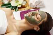 Face Peeling Mask, Spa Beauty Treatment, Skincare. Woman Getting Facial Care By Beautician At Spa Sa poster