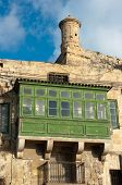 traditional wooden balconies and watch tower in Valletta, Malta