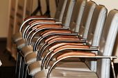 A Row Of Modern Metal Office Chairs Near The Table In A Conference Room. Blank Illustrative Backgrou poster