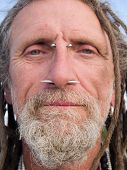 stock photo of facial piercings  - Face of an eccentric gentleman with pierced nasal septum