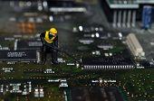 Miniature woker on motherboard