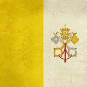 Grunge sovereign state flag of country of Vatican City in official colors.