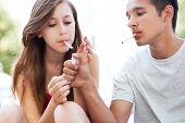stock photo of teen smoking  - Teenage couple smoking - JPG