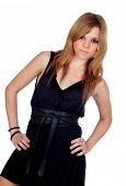 Teen rebellious girl with a black dress isolated on a over white background