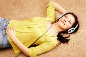 Beautiful Women Listening Music In Headphones