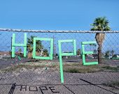 Hope, spelled out in letter form on fence in down town Los Angeles rundown area