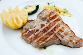 Florentine style steak with lemon poster