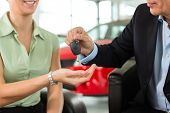 picture of rep  - Woman at a car dealership buying an auto - JPG