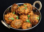 Indian vegetable pakoras made from potato, spinach, cauliflower and onion.