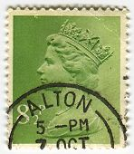 UK-CIRCA 1960:A stamp printed in UK shows image of Elizabeth II is the constitutional monarch of 16