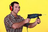 Man with a power drill
