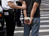 NEW YORK - SEPT 17: Plastic handcuffs on an unidentified man being arrested during the 1yr anniversa