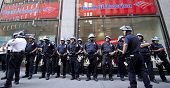NEW YORK - SEPT 17: Police in riot gear assemble in front of a Bank of America branch on Broadway on the 1yr anniversary of the Occupy Wall St protests on September 17, 2012 in New York City, NY.