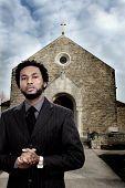 Man near church with dark scary clouds