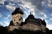 Sunset above the royal castle Karlstejn in Czech Republic