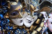 image of mardi-gras  - Row of venetian masks in gold and blue - JPG