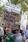NEW YORK - SEPT 17: A protester opposing fracking holds a sign that reads 'You Cant Drink Money'  on the 1yr anniversary of the Occupy Wall St protests on September 17, 2012 in New York City, NY.