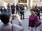 NEW YORK - SEPT 17: Tourists take pictures as police guard the Charging Bull sculpture  in Bowling G