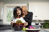 stock photo of love making  - Couple making salad in kitchen - JPG