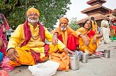 KATHMANDU, NEPAL - MAY 19: Holy Sadhues  with traditional blessing in Durbar Square on May 19, 2013