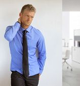 stock photo of office romance  - Portrait of a sexy handsome young professional man - JPG