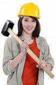 Female labouror holding  hammer