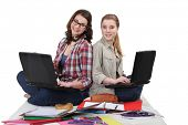 Two female students with laptops