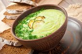 zucchini cream soup in a ceramic bowl