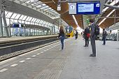 Travellers waiting for the train in Bijlmer station Amsterdam the Netherlands