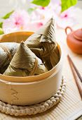 Hot rice dumpling or zongzi. Traditional steamed sticky  glutinous rice dumplings. Chinese food dim