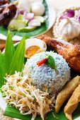 Nasi kerabu or nasi ulam, popular Malaysian Malay rice dish. Traditional east coast blue rice. Famou