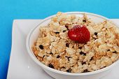 Closeup Bowl Of Cereal With Blueberries And A Strawberry