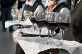pic of waiter  - Waiter with dish of wine and juice glasses - JPG