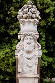 stock photo of garden sculpture  - Replica sculpture in the Villa Borghese garden in Rome which is a large landscape garden in the naturalistic English manner in Rome containing a number of buildings museums and attractions - JPG