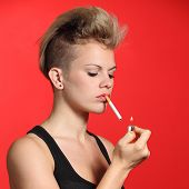 Fashion Woman Lighting A Cigarette