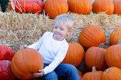 Child At Pumpkin Patch
